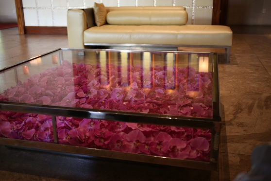 This beautiful table in The Cove lobby is filled with fresh orchids.  The flowers are replaced once a week.