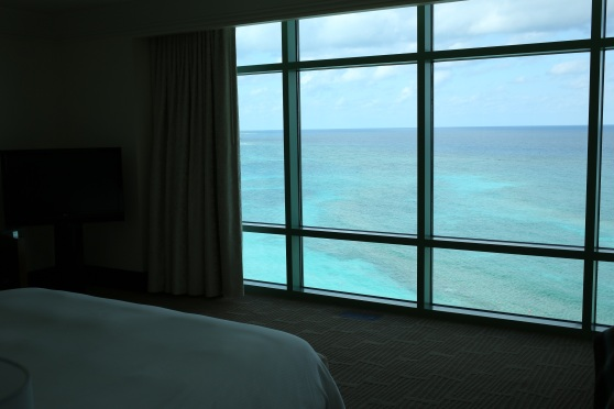 Yes.  That is a corner of the bed that you see.  And yes, that is a floor-to-ceiling window, overlooking the Caribbean!