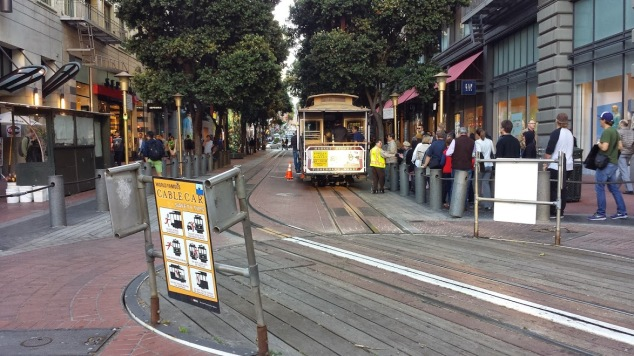 Grab a cable car at lots of stops throughout the city!  Need some help planning your trip to San Fran?  I can help tell you where to pick up the cable car, and what time is best.  ;)