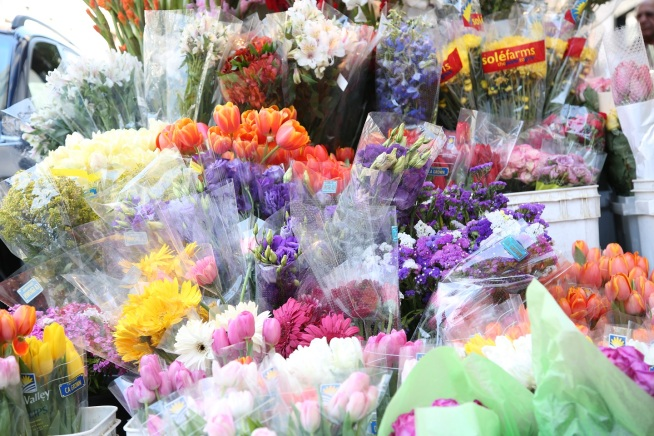 Flower vendors make the streets smell like lilies and roses in May.